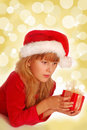 Girl with christmas gift on shining background Stock Image