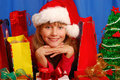 Girl and christmas gifts Royalty Free Stock Image