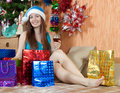 Girl in christmas gifts Stock Image