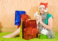 Girl  with Christmas gifts and rabbits Royalty Free Stock Photography