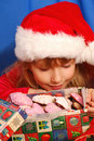 Girl and christmas gingerbreads Royalty Free Stock Images