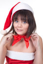 Girl in christmas hat beautiful wearing making red ribbon bow on her neck Royalty Free Stock Images