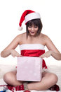 Girl in christmas hat opening present beautiful wearing Stock Photos
