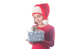 Girl with a christmas hat and a present Royalty Free Stock Images