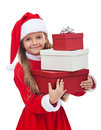 Girl in christmas outfit holding presents and smiling isolated Stock Photography