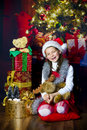 Girl with christmas present young holding Stock Photos
