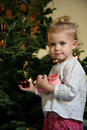 Girl and christmas tree Royalty Free Stock Image
