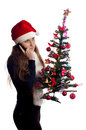 Girl with Christmas tree Stock Images