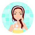 Girl Clean her Face with Lotion and Sponge Royalty Free Stock Photo