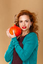 Girl with a clean skin holding a pumpkin. Royalty Free Stock Photo
