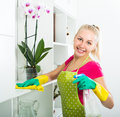 Girl cleaning in apartment