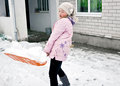 Girl cleans snow Stock Images