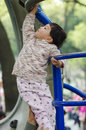 Girl climb ladder Royalty Free Stock Photography