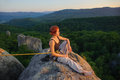 Girl climber on mountain peak on high altitude in evening Royalty Free Stock Photo