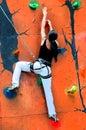 Girl climbing on a climbing wall Royalty Free Stock Photo