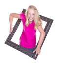 A girl climbing through a picture frame Royalty Free Stock Image