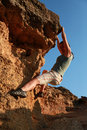 Girl climbing at rock at outdoor Royalty Free Stock Photography