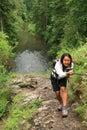 Girl climbing a rock in Slovak Paradise