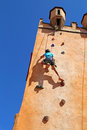 Girl climbing rock wall Royalty Free Stock Photo