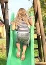 Girl climbing a slide