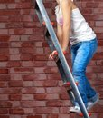 Girl climbing the stairs to the top Royalty Free Stock Photo