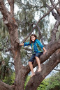 Girl climbing tree young on holidays Royalty Free Stock Photography