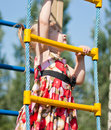 Girl climbs on the ladder Royalty Free Stock Photo