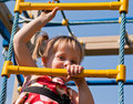 Girl climbs on the ladder Stock Photos