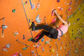 The girl climbs the steep wall on climbing gym Royalty Free Stock Image