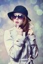 Girl in cloak redhead as a spy studio shot Stock Photography