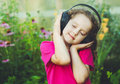 Girl closed her eyes and listen to music on headphones. Instagra Royalty Free Stock Photo