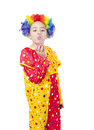 Girl in clown costume blowing air bubbles Stock Photo