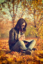 Girl with coffee cup reading a book Royalty Free Stock Photo