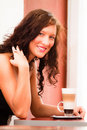 Girl with a coffee latte macchiatto Stock Photos