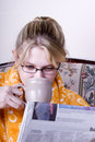 Girl with coffee and paper Royalty Free Stock Image