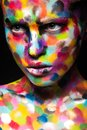 Girl with colored face painted. Art beauty image. Royalty Free Stock Photo
