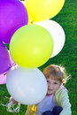 A girl with colorful balloons Royalty Free Stock Images