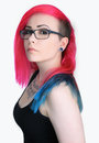 Girl with colorful hair and glasses pink blue lips pierce tattoo on a white background Stock Images