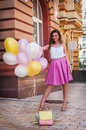 Girl with colorful latex balloons, urban scene, outdoors Royalty Free Stock Photo