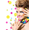 Girl with colorful makeup beauty nail polish and accessories Royalty Free Stock Photo