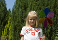 Girl with colorful pinwheel Royalty Free Stock Photography