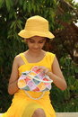 Girl with colorful purse Stock Images
