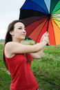 Girl with a colorful umbrella Stock Photos