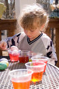 Girl Coloring Easter Eggs Stock Image