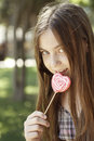 Girl with colouring lollipop and sweet Royalty Free Stock Photos