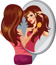 Girl combing her hair before a mirror Royalty Free Stock Images