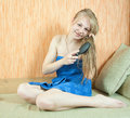 Girl combing her long hair Royalty Free Stock Photography