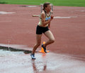 Girl compete in the 3.000 Meter Steeplechase Stock Photos