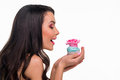 Girl with confection in profile cute brunette is going to eat bakery her hands seductive blue cupcake rosy marchpane Stock Photo