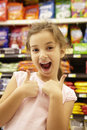 Girl in confectionery supermarket confectionery aisle Royalty Free Stock Photography